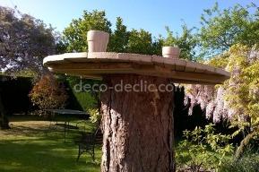 Idée bricolage pour transformer une souche d'arbre en table de jardin